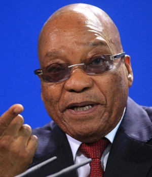 Jacob Zuma, South Africa's president, gestures as he speaks during a news conference with Angela Merkel, Germany's chancellor, at the Chancellery in Berlin, Germany, on Tuesday, Nov. 10, 2015. European Union President Donald Tusk said Germany needs to make it clear that Europe's ability to absorb refugees is limited, challenging Chancellor Angela Merkel to signal toughness alongside moral principles. Photographer: Krisztian Bocsi/Bloomberg *** Local Caption *** Jacob Zuma