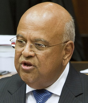 South African Minister of Finance Pravin Gordhan delivers the 2014 Budget speech at the South African Parliament, on February 26, 2014, in Cape Town. South Africa's government presented a restrained budget today which largely sticks to existing spending limits even though voters are clamouring for election-year spending. Meanwhile the state of South African public finances is under the spotlight of credit ratings agencies. AFP PHOTO / RODGER BOSCH / AFP / RODGER BOSCH