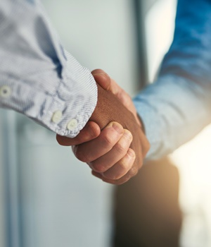 Closeup shot of businesspeople shaking hands in an office