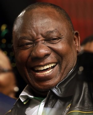 FILE -- In this Wednesday, July 5, 2017 file photo South Africa's deputy president Cyril Ramaphosa, takes a selfie at the end of the ANC's policy conference in Johannesburg, South Africa. As the African National Congress meets this weekend to choose a successor to scandal-ridden President Jacob Zuma, the race between his deputy and ex-wife, Dlamini-Zuma threatens to split Nelson Mandela's legacy. (AP Photo/Themba Hadebe. File)