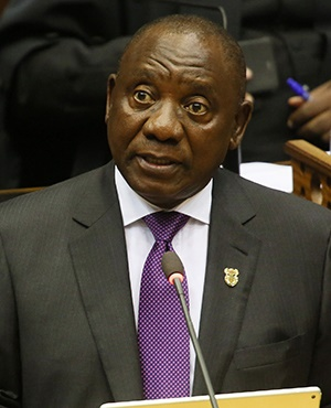 South Africa's newly-minted president Cyril Ramaphosa delivers his State of the National address at the Parliament in Cape Town, on February 16, 2018.  The State of the Nation address is an annual mix of political pageantry and policy announcements, but the flagship event was postponed last week as Zuma battled to stay in office. / AFP PHOTO / POOL / Ruvan BOSHOFF